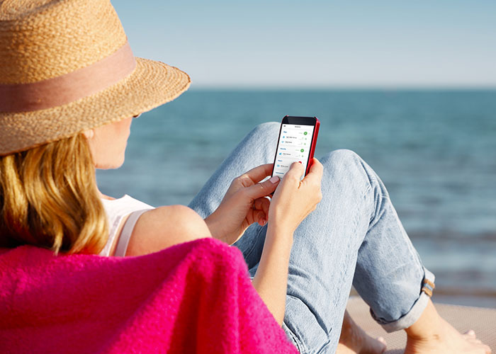 Lady on her phone at the beach